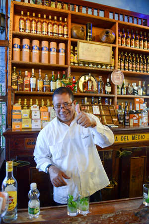 hemingway: Havana, Cuba - 6 january 2016 - barkeeper preparing alcoholic drinks at La Bodeguita del Medio restaurant in Old Havana, Cuba