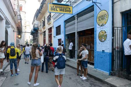 hemingway: Havana, Cuba - 6 january 2016 - People walking and taking pictures in front of La Bodeguita del Medio restaurant in Old Havana, Cuba Editorial