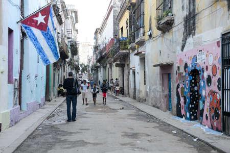 vieja: Havana, Cuba - 6 January 2016: People walking on the street at the neighborhood of Habana Vieja in Havana on Cuba