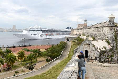 Havana, Cuba - 26 January 2016: people watching a cruiser ship entering the bay of Havana on Cuba