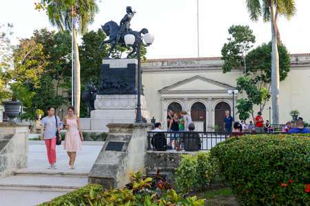 ignacio: Camaguey, Cuba - 11 January 2016: People walking in front of the Ignacio Agramonte monument at Ignacio Agramonte Park in Camaguey, Cuba