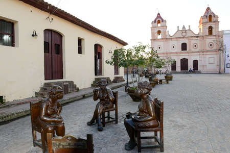 martha: Camaguey, Cuba - 11 January 2016: Statues of artist Martha Jimenez in front of the Carmen church at Camaguey on Cuba
