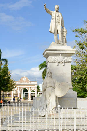 national hero: Cienfuegos, Cuba - 18 january 2016: People walking in front of the monument to Jose Marti, the cuban national hero at the Marti Park in Cienfuegos, Cuba