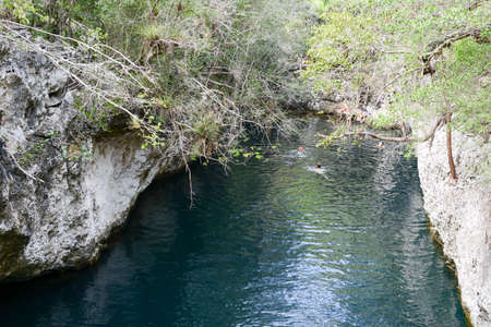 Giron, Cuba - 20 january 2016: people swimming on a cenote at Giron on Cuba