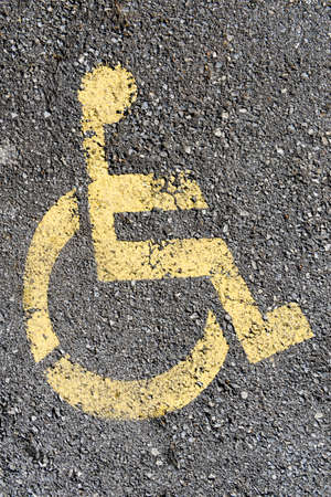 physically: Sign for parking space reserved for disabled people