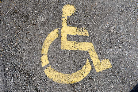 designated: Sign for parking space reserved for disabled people