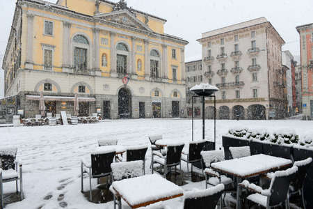 swizerland: Lugano, Swizerland - 5 march 2016: Its snowing on piazza della Reforma who is the main square of Lugano on Switzerland.