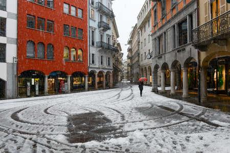 Lugano, Swizerland - 5 march 2016: Its snowing on via Nassa who is the main pedestrian street of Lugano on Switzerland. Editorial