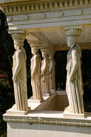 eras: Morcote, Switzerland - 13 april 2016: Scherrer Park on Morcote, Switzerland. Called The Garden of Wonders. a rich collection of art objects from different countries and different eras Editorial