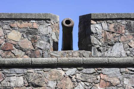 colonia del sacramento: Old cannon behind the fortress wall in Colonia del Sacramento, Uruguay Stock Photo