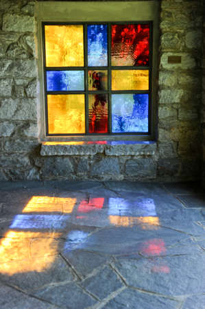 stained glass windows: Modern stained glass windows reflecting colors on church walls and floor