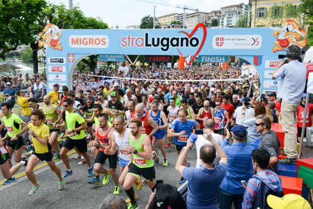 tightly: Lugano, Switzerland - 22 may 2016: Marathon runners packed tightly together right out of the starting line of StraLugano half marathon.