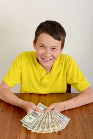 proudly: Child showing proudly his money