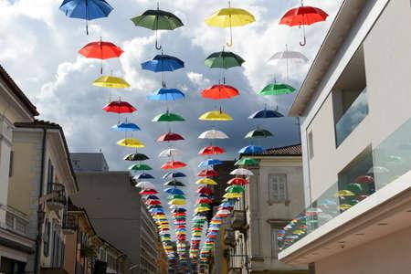 Chiasso, Switzerland - 5 June 2016: many colorful umbrellas hanging on the pedestrian street of Chiasso on Switzerland Editorial