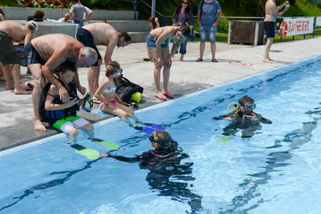Massagno, Switzerland - 12 June 2016 -Childrens discover Scuba Diving on a swimming pool at Massagno on the italian part of Switzerland