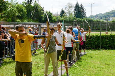 Massagno, Switzerland - 12 June 2016 - people who are learning to archery at Massagno on the italian part of Switzerland Editorial