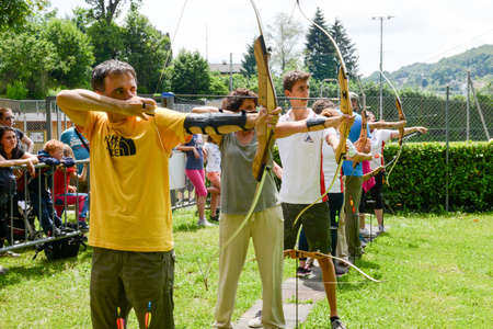 recurve: Massagno, Switzerland - 12 June 2016 - people who are learning to archery at Massagno on the italian part of Switzerland Editorial