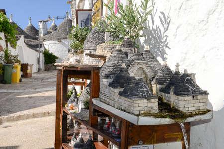 Alberobello, Italy 21 June 2016: Beautiful town of Alberobello with trulli houses, Unesco world heritage on Puglia, southern Italy Editorial