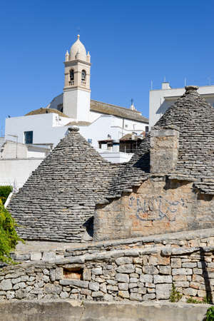 unesco world cultural heritage: Alberobello, Italy 21 June 2016: Beautiful town of Alberobello with trulli houses, Unesco world heritage on Puglia, southern Italy Editorial