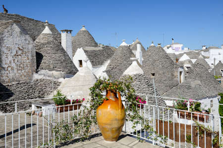 Alberobello, Italy 21 June 2016: Beautiful town of Alberobello with trulli houses, Unesco world heritage on Puglia, southern Italy Editorial
