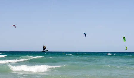 kiteboarding: Torre Canne, Italy - 22 June 2016: People practicing kitesurf on the beach of Torre Canne on Puglia, Italy Editorial