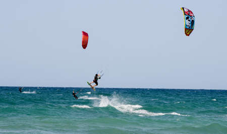 Torre Canne, Italy - 22 June 2016: People practicing kitesurf on the beach of Torre Canne on Puglia, Italy Editorial