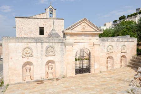friso: Church of Santa Maria di Costantinopoli at Cisternino on Puglia, Italy. Foto de archivo