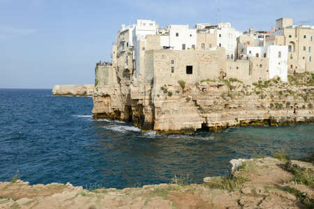 Polignano a mare, Italy - 23 June 2016: people visiting on walking the scenic small town built on rocks in Puglia, Italy
