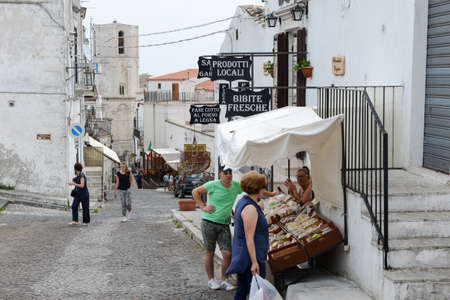 Monte SantAngelo, Italy - 28 June 2016: people shopping on the tourist shops of Monte SantAngelo on Puglia, Italy.