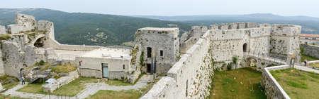 Monte SantAngelo, Italy - 28 June 2016: people walking on the walls of Castle at Monte SantAngelo on Puglia, Italy.