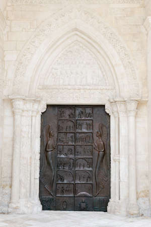 Entrance door of St Michael basilica at Monte SantAngelo on Puglia, Italy