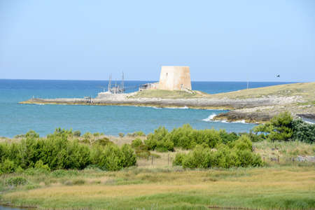 inlet bay: Old watchtower near Vieste on Puglia, Italy