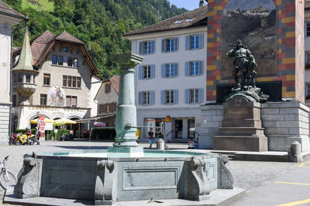 Altdorf, Switzerland - 7 august 2016: people walking and looking at Wilhelm Tell monument on the cantonal capital of Altdorf in the Canton of Uri, Switzerland
