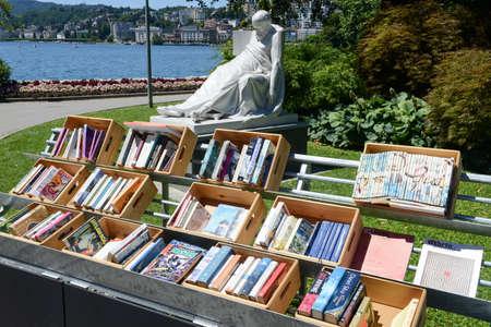 Lugano, Switzerland - 18 July 2016: Row of vintage books free copy space on central park of Lugano on Switzerland