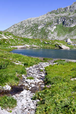 place of interest: Lake at Gotthard pass on the Swiss alps Stock Photo