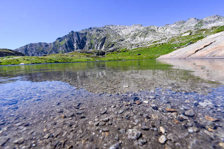 ancient pass: Lake at Gotthard pass on the Swiss alps Stock Photo