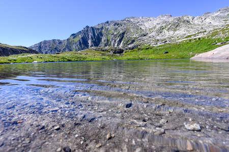 singularity: Lake at Gotthard pass on the Swiss alps Stock Photo
