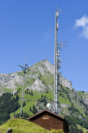Engelberg, Switzerland - 8 august 2016: Mountain landscape with communication antenna over Engelberg on the Swiss alps