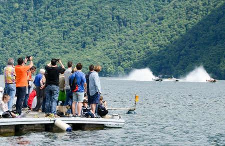 Lugano, Switzerland - 5 June 2016: people audience of XCat World Offshore Speed boat Championship on lake of Lugano on Switzerland
