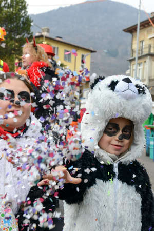 newsworthy: Tesserete, Switzerland - 13 February 2016: people posing at the carnival of Tesserete on the italian part of Switzerland