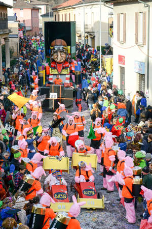 satirical: Tesserete, Switzerland - 13 February 2016: people marching in the parade of the carnival at Tesserete on the italian part of Switzerland Editorial
