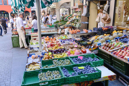 Lugano, Switzerland - 25 august 2016: people shopping at a fresh fruit and vegetables market of Lugano on the italian part of Switzerland