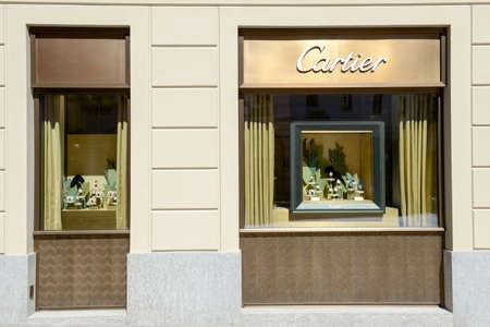 watchmaker: Lugano, Switzerland - 25 august 2016: showcases of Cartier watchmaker store at Lugano on Switzerland