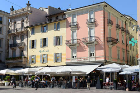 ticinese: Lugano, Switzerland - 25 august 2016: people eating and drinking at the restaurants in the central square of Lugano on Switzerland Editorial