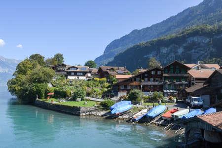 lake front: Iseltwald, Switzerland - 24 September 2016: people walking on the lake front of Iseltwald on lake Brienz, Switzerland