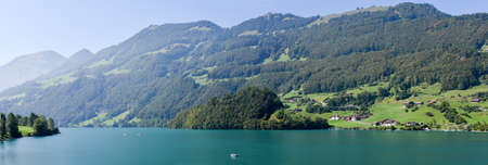 Lungern, Switzerland - 24 September 2016: People fishing on them boats at lake Lungern on Canton Obwalden in Switzerland Stock Photo