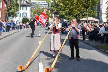 alphorn: Ennetbuergen, Switzerland - 24 September 2016: People wearing traditional clothes and playing the alphorn at Ennetbuergen on the Swiss alps Editorial