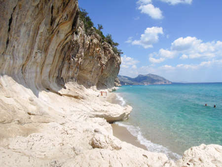 LUNA: Cala Luna, Italy: people swimming and sunbathing at Cala Luna beach on Sardinia, Italy