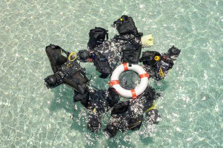 regulator: Scuba diving tank and regulator on the sea