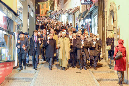 devote: Lugano, Switzerland - 17 novembre 2015: group of people during the interfaith procession against terrorism in the streets of Lugano on Switzerland Editorial